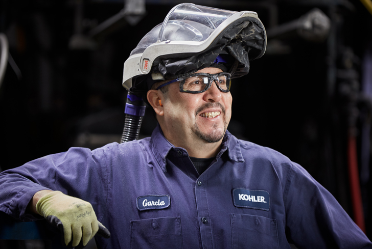 Color photo of Cast iron foundry operator smiling