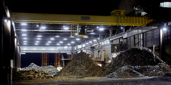 Nighttime view of well-lit scrap yard to support three shift operation